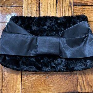 NWT INC faux fur clutch with a bow